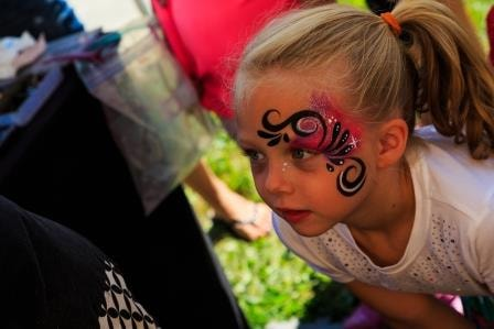 A third girl getting her face painted