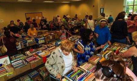 Many people shopping for books at the sale