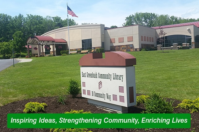 Image of the library with the tagline: Inspiring Ideas. Strengthening Community. Enriching Lives.