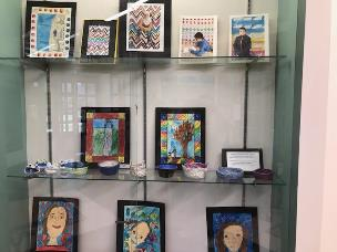 several art objects in a glass display case