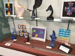 art objects in a glass display case
